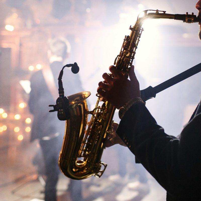 Man plays on a saxophone